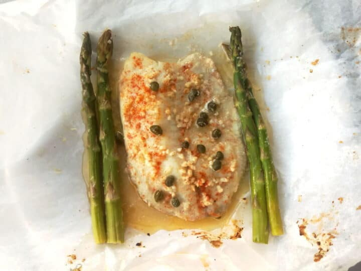 fish in parchment paper with capers and asparagus