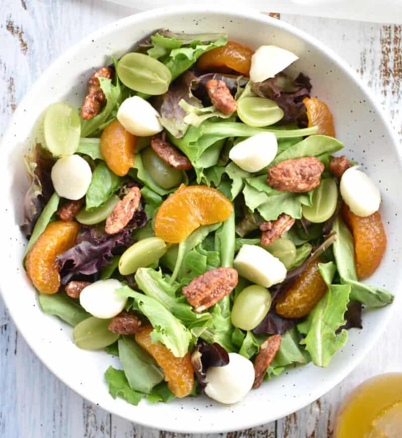 Spring mix salad with mandarin, green grapes, fresh mozzarella and candied pecans.