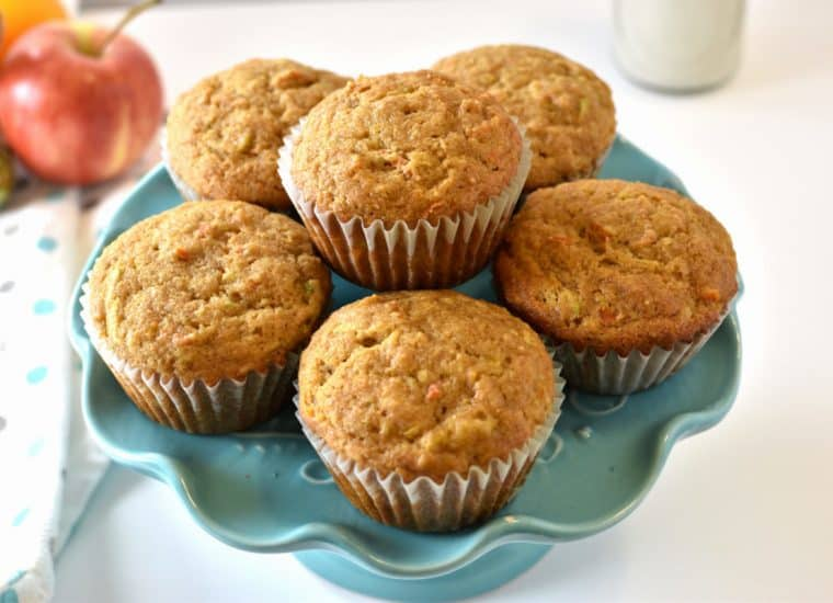 Muffins made with zucchini, carrot, orange and applesauce on a blue stand