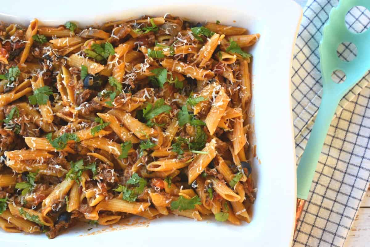 Penne in a mexican sauce with cheese, cilantro, olives and mushrooms in a cassarole. One pot taco pasta.