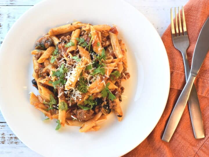 plate with penne, mushroom and taco seasonings