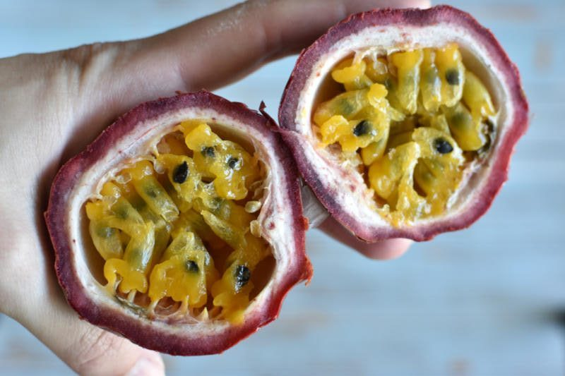 Passion fruit cut in half. With the pulp showing off