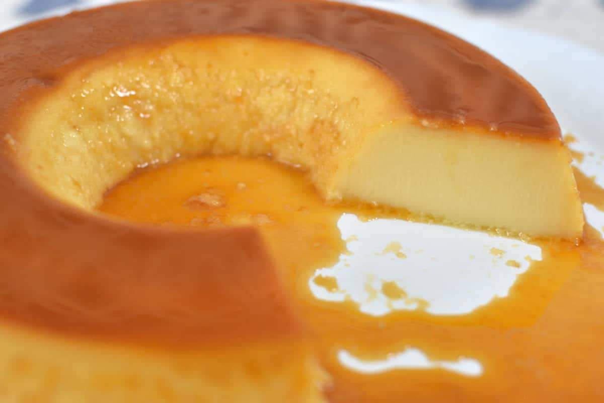 Cut Brazilian Flan with caramel sauce