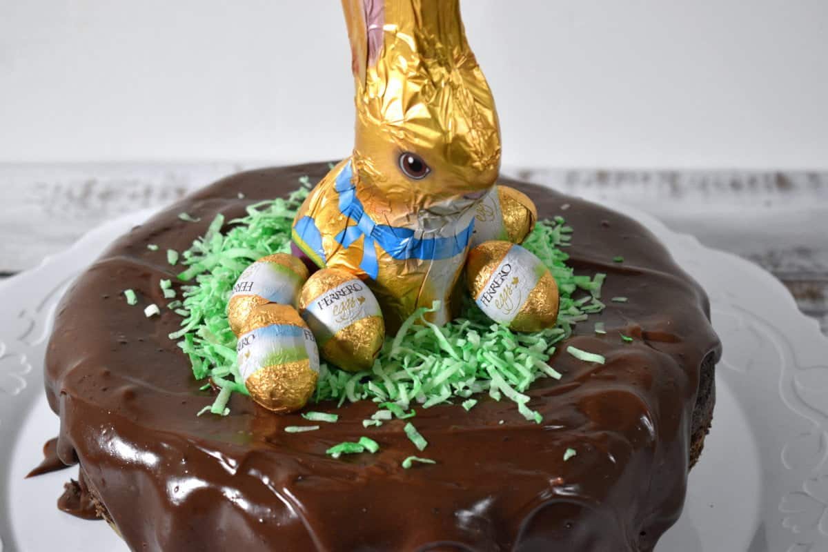 chocolate cake covered with chocolate frosting decorated for easter