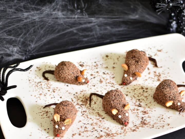 Strawberry and chocolate fudge rats on a white tray