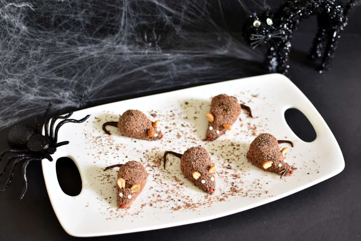 strawberry and chocolate fudge mice on a white tray (Halloween dessert)