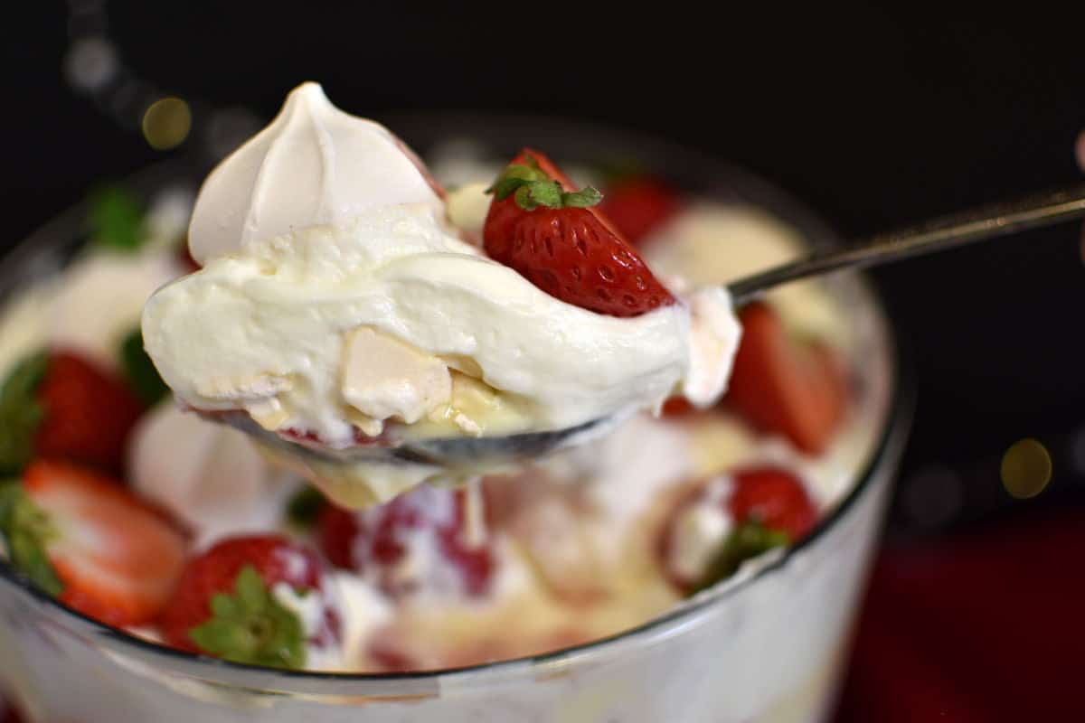 Spoonful of strawberry trifle