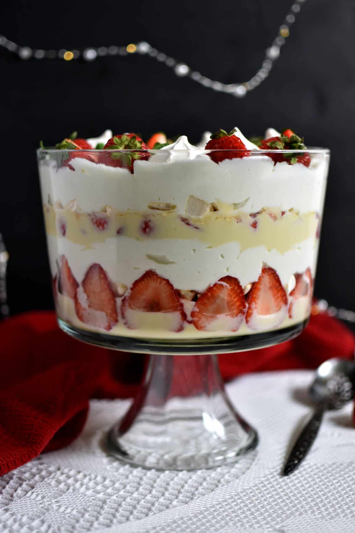 Layers of a strawberry trifle in a trifle bowl