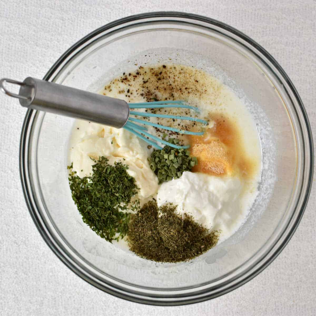 ingredients for homemade buttermilk ranch in a bowl