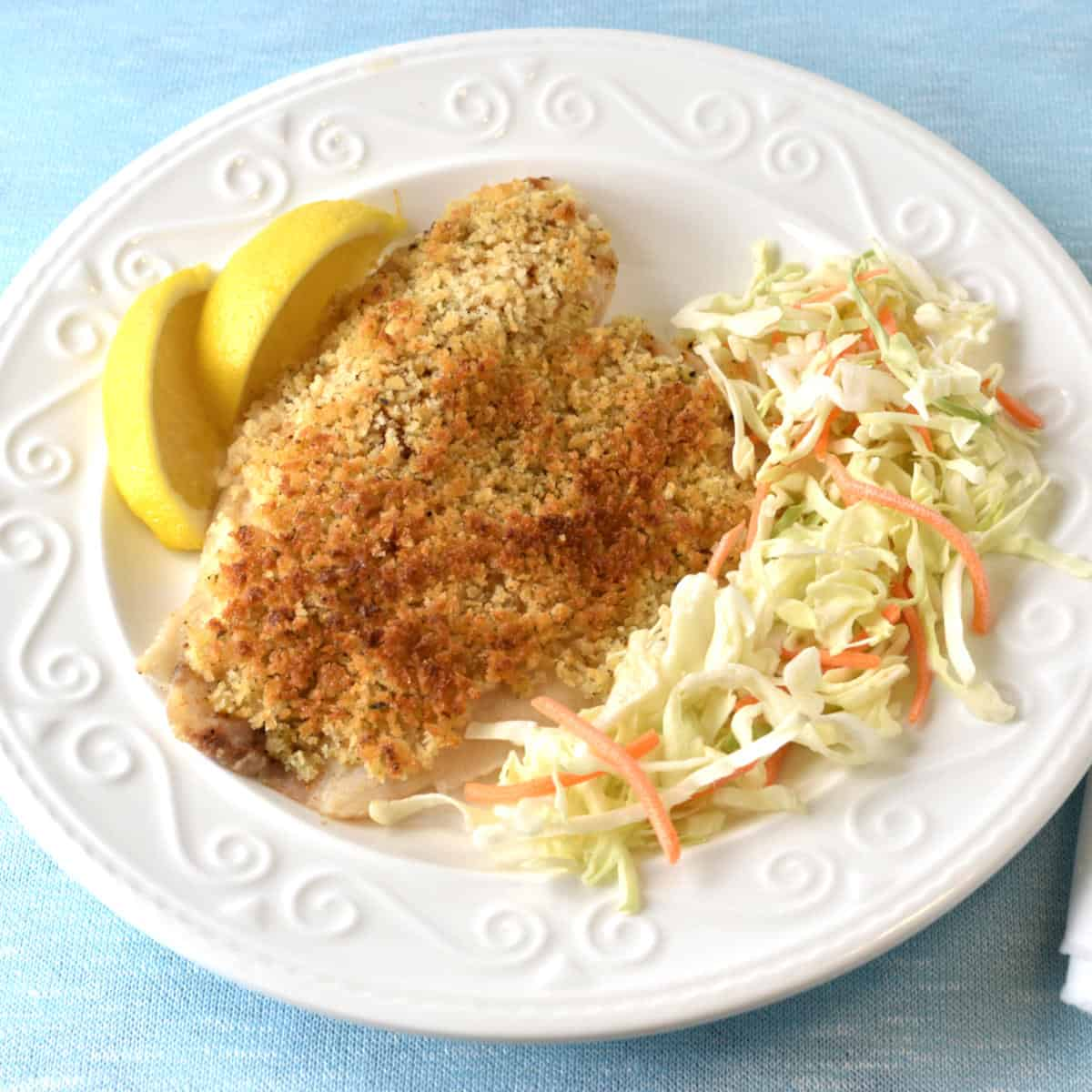Tilapia with Panko mixture crust with salad and lemon on the side