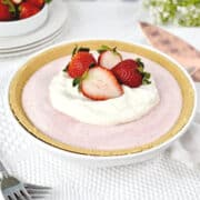 Frozen strawberry pie with whipped cream and strawberries on top
