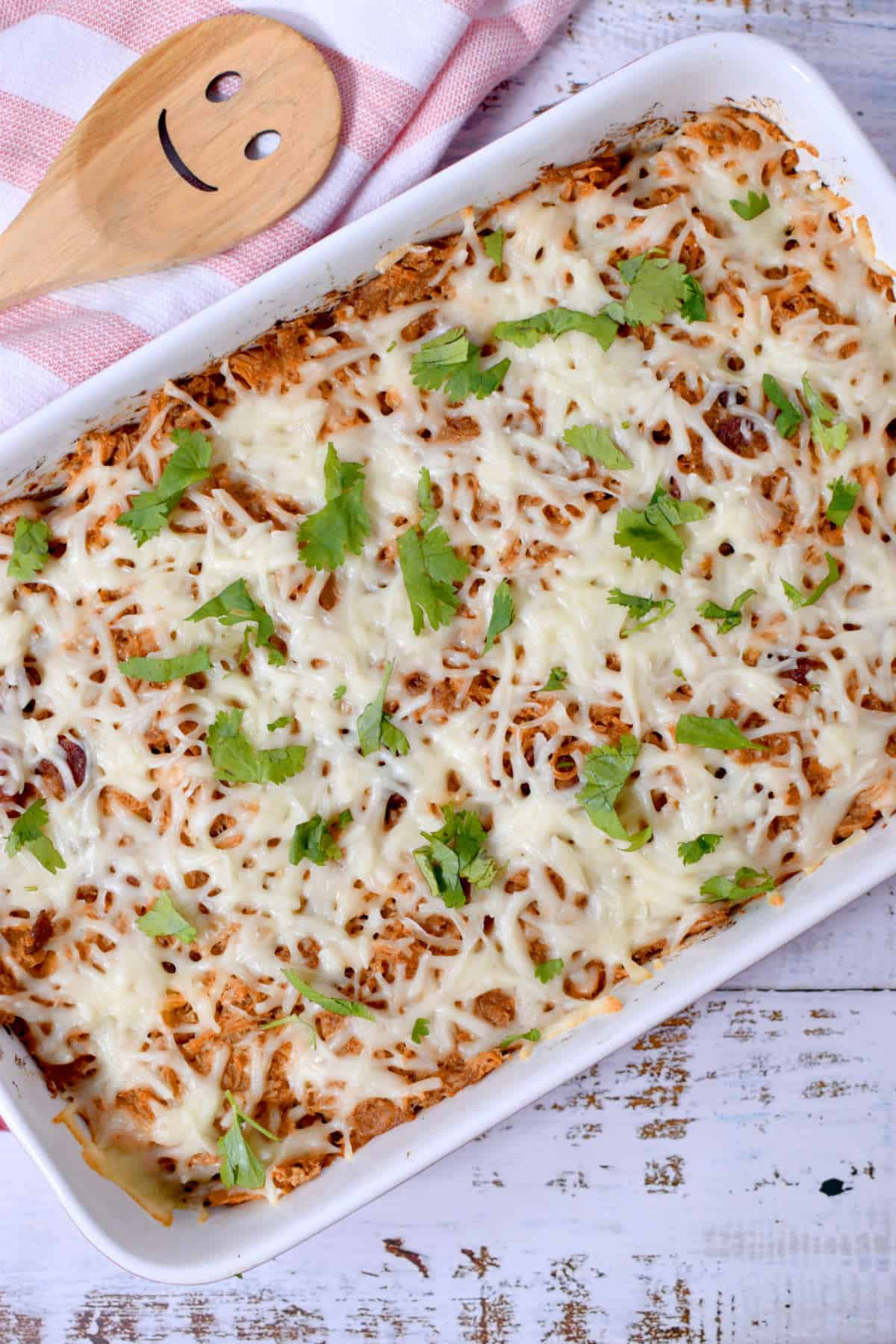 chicken and sweet potato casserole topped with cheese and parsley