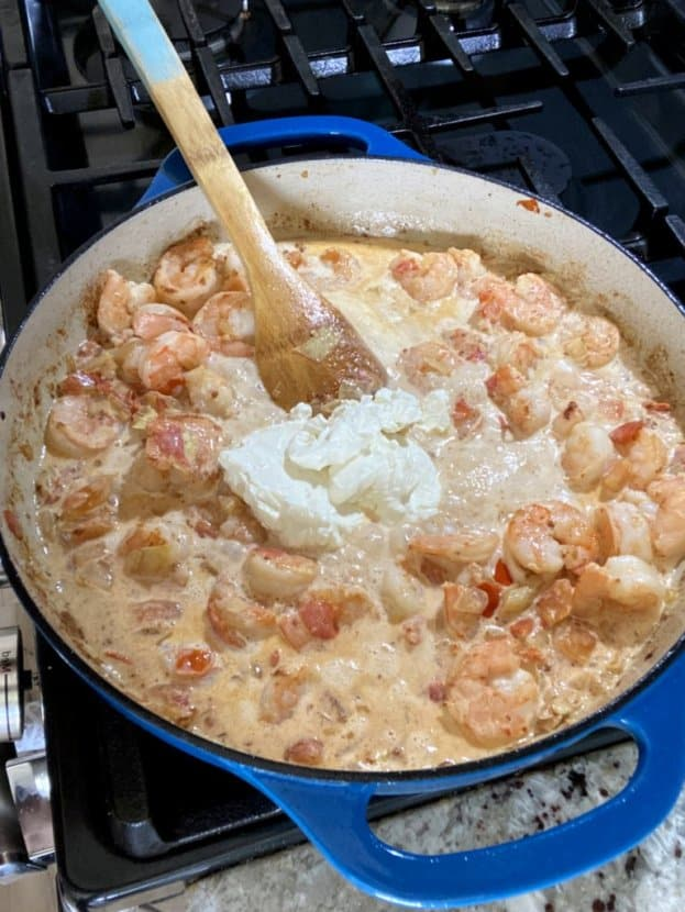 shrimp chowder being prepared in an enameled pan